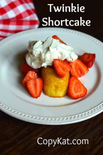 Cut up strawberries served over a twinkie with whipped cream.