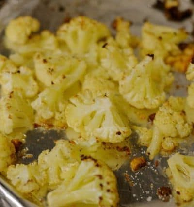cauliflower being roasted with coconut oil