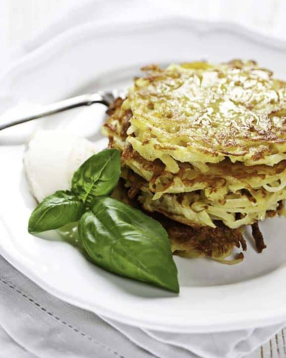 a stack of potato pancakes on a plate