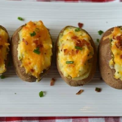 twice baked potatoes on a white plate