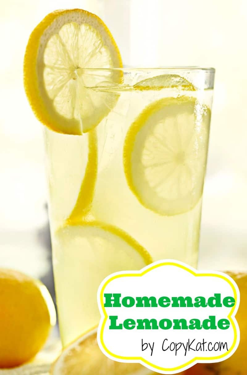 a glass of lemonade with lemon slices