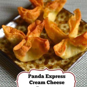 Three homemade Panda Express Cream Cheese Rangoons on a plate.