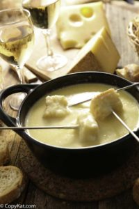 Homemade copycat Melting Pot Swiss Fondue with bread pieces in it.