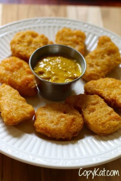 Homemade McDonald's Hot Mustard and chicken nuggets on a plate.