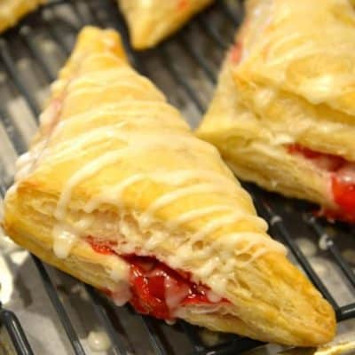 cherry turnovers on a baking sheet