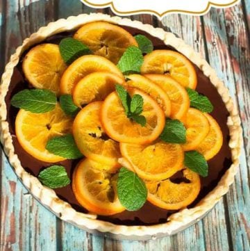 Dark Chocolate Tart with candied orange slices from CopyKat.com