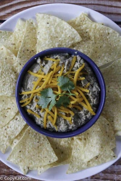 a bowl of refried beans with cheese on top