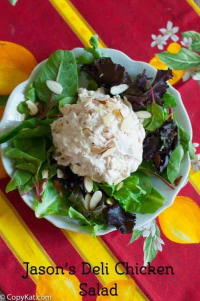 Homemade copycat Jason's Deli Chicken Salad on top of mixed greens on a plate.