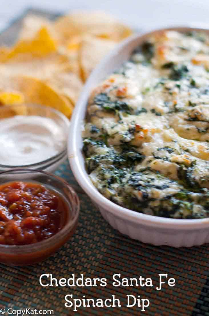 Homemade copycat Cheddars Santa Fe Spinach Dip in a white baking dish