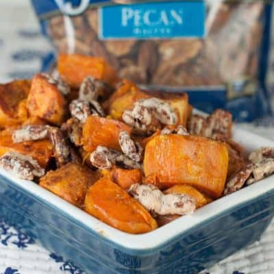 Roasted Sweet Potatoes with Candied Pecans in a baking dish