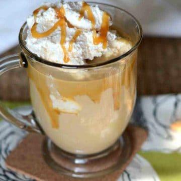 Homemade caramel macchiato in a glass mug