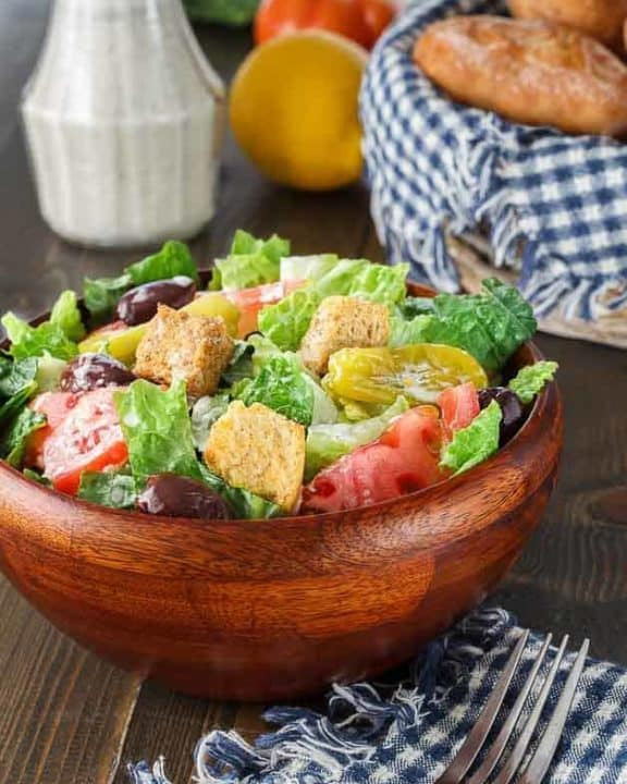 Homemade copycat Olive Garden Salad Dressing and a salad.