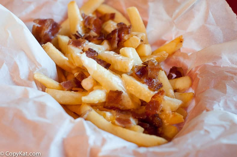 bacon cheese fondue fries on parchment paper