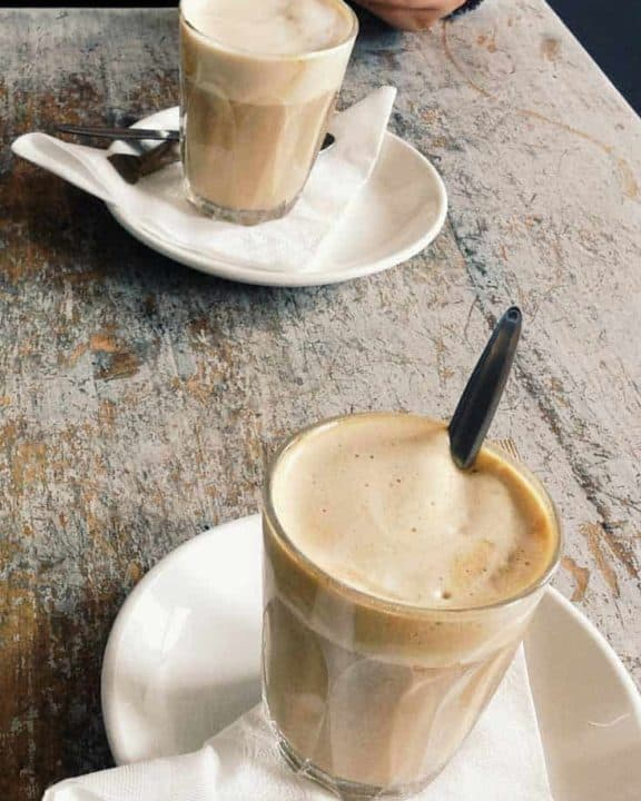 Two smoked butterscotch lattes on a table