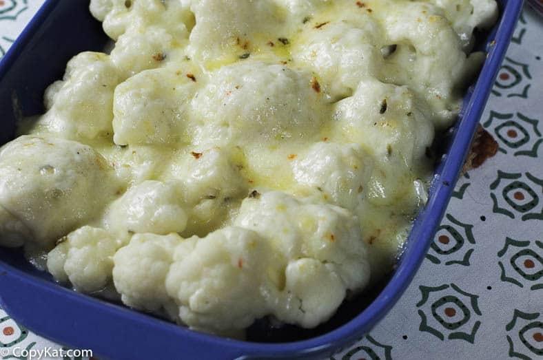 Pepper Jack Cauliflower Gratin in a blue casserole dish.