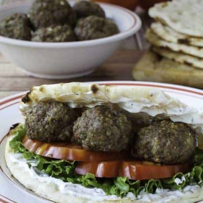 Greek meatballs in pita bread and a bowl