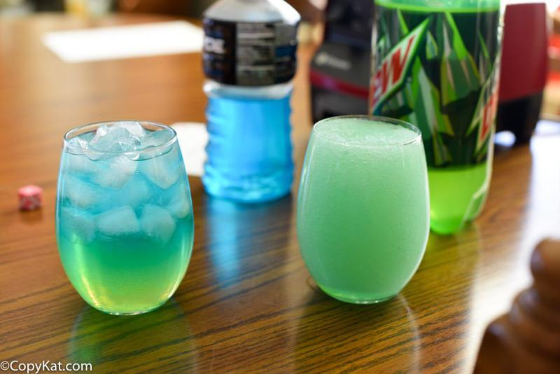 Two glasses of homemade Taco Bell Baja Blast drinks on a table