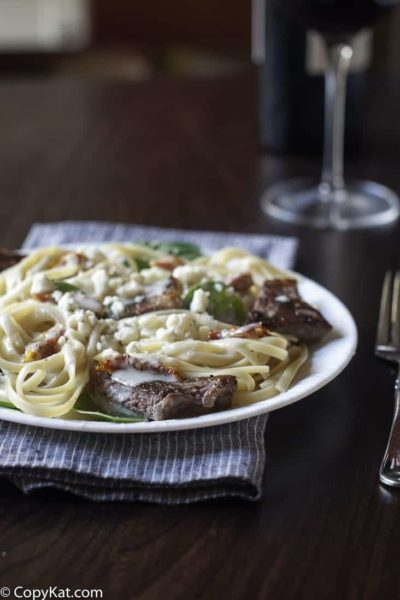 Homemade copycat Olive Garden Steak Gorgonzola Alfredo Pasta on a plate.