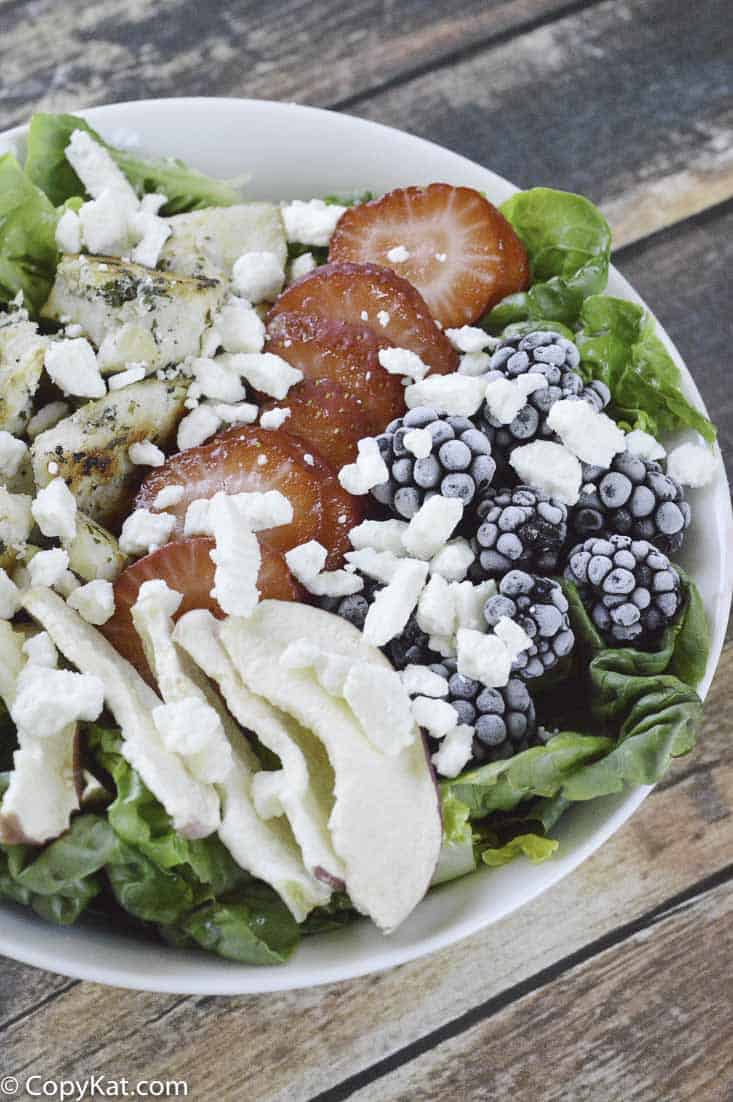 a bowl of summer berry chicken salad