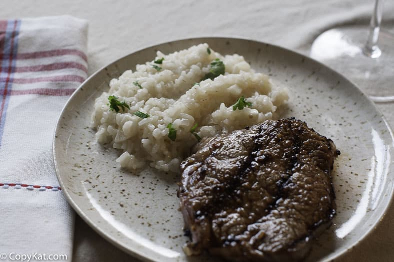 steak and parmesan risotto on a plate