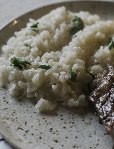 parmesan risotto and steak on a plate