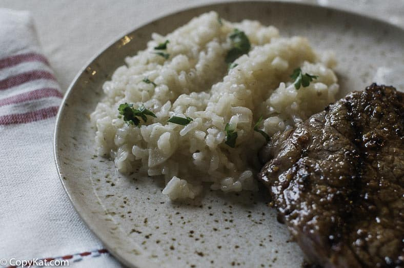Steak and parmesan risotto on a plate.