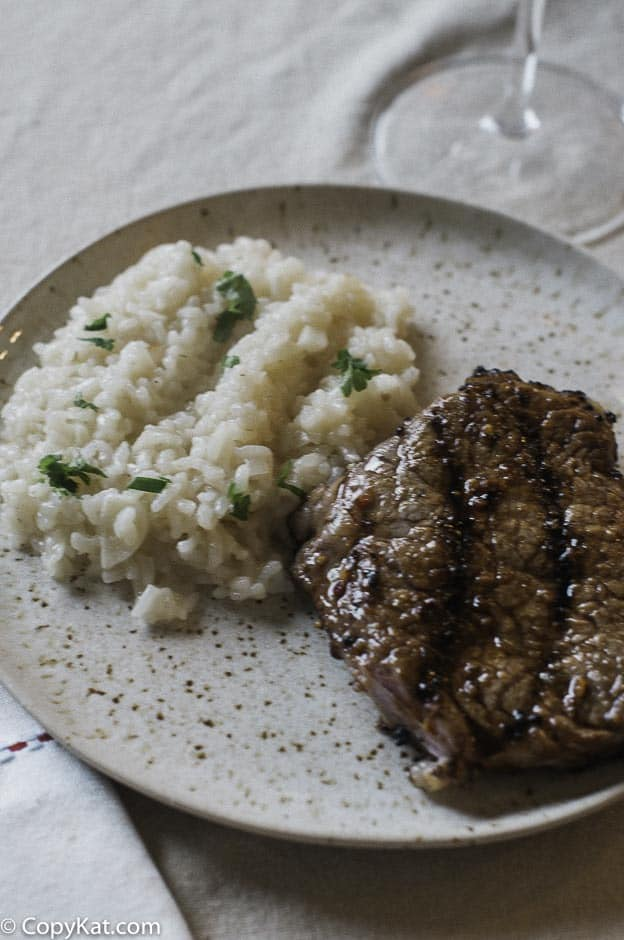 Instant Pot parmesan risotto and steak on a plate.