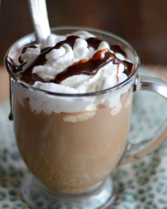 Homemade copycat Starbucks Cafe Mocha with whipped cream in a glass mug.