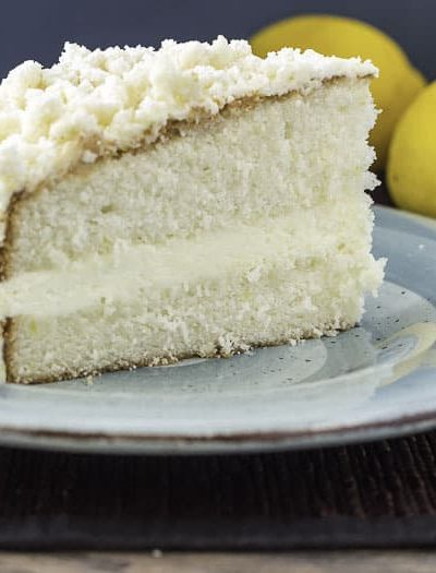 A slice of homemade Olive Garden lemon cream cake on a plate.