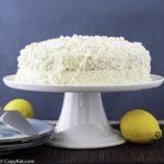 Homemade Olive Garden Lemon Cream Cake on a cake stand.