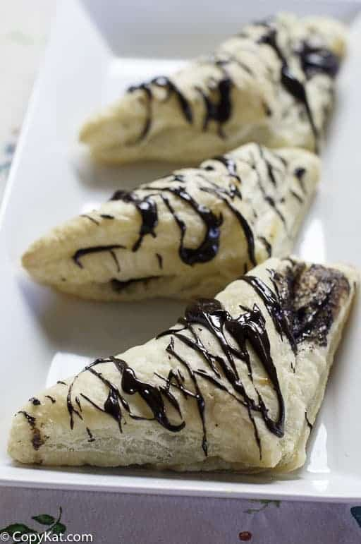 three homemade Arby's chocolate turnovers on a platter