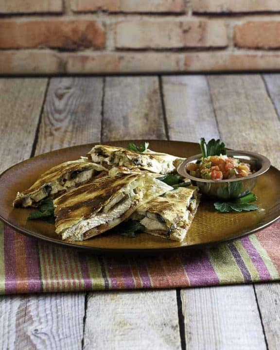 Homemade copycat Alice Springs Quesadilla on a brown plate.