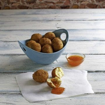 Homemade Captain Ds hush puppies in a blue bowl