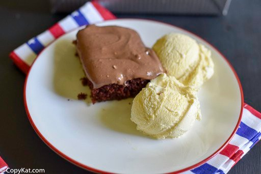 double fudge coca cola cake and ice cream on a plate