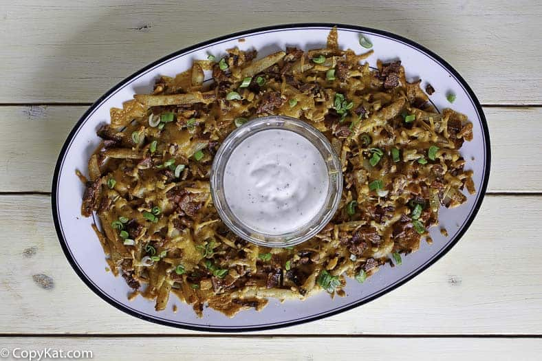 A platter of homemade Cheddars Texas Cheese Fries with ranch dip