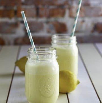 Two mugs of frozen lemonade.