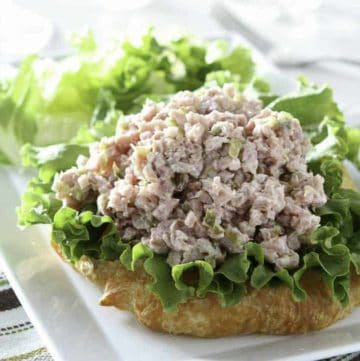 Homemade ham salad and lettuce on a croissant