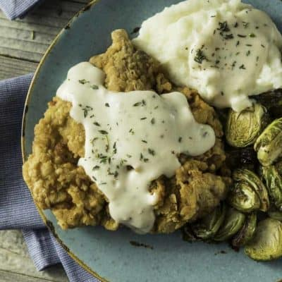 Homemade Southern Chicken Fried Steak and gravy with Brussels sprouts and mashed potatoes