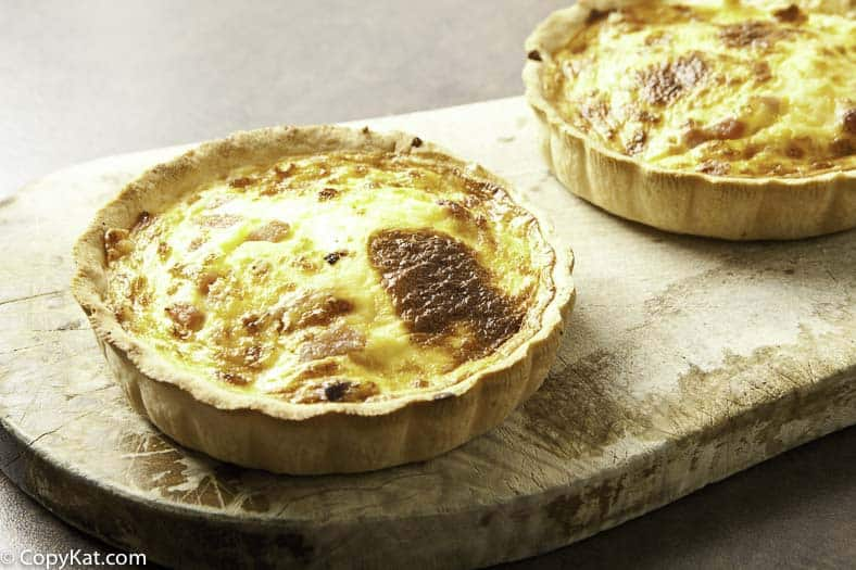Two quiche lorraines in pie tins