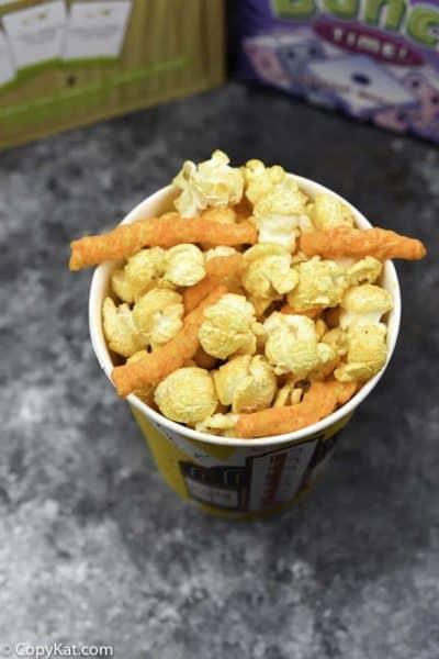 Make a delicious snack of Cheetos Popcorn.
