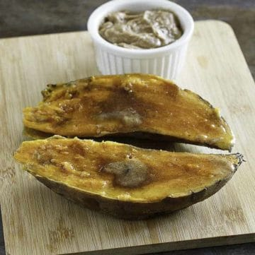 Homemade copycat Outback Steakhouse Sweet Potato topped with honey butter, cinnamon, and brown sugar.