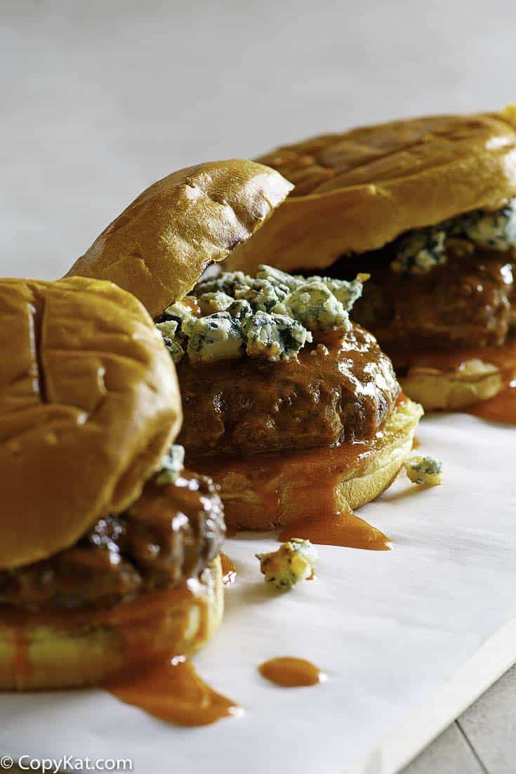 Three Buffalo Blue Cheese Burgers