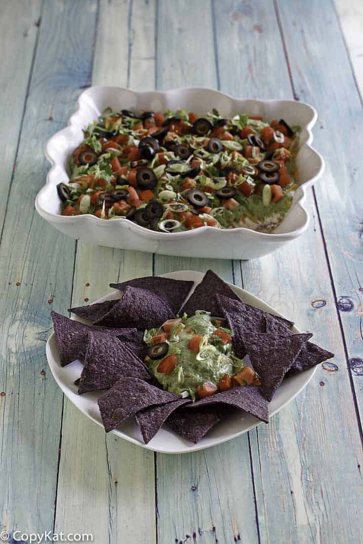 You can recreate the famous TGI Friday 9 Layer Dip at home with this easy copycat recipe.