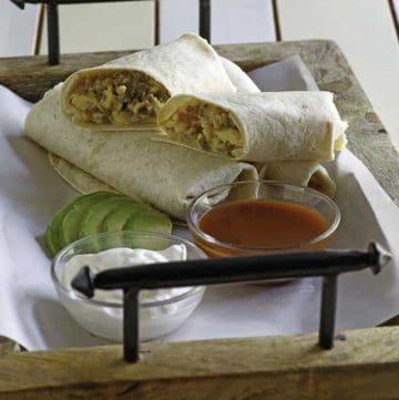 sausage breakfast burritos on a tray