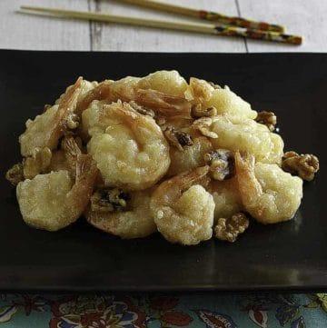 Homemade Panda Express Honey Walnut Shrimp on a black plate.