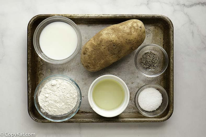 russet potato, vegetable oil, flour, and seasonings on a tray