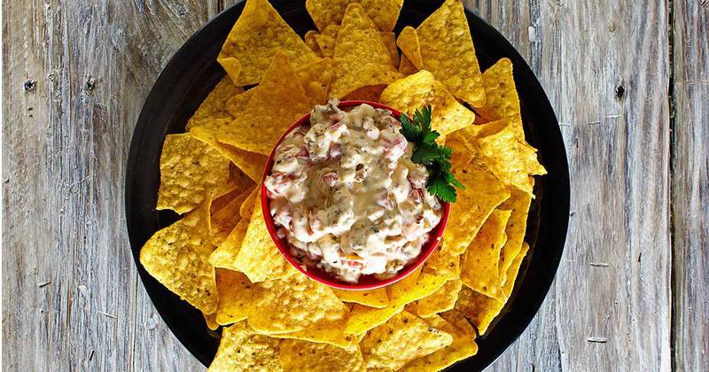 Rotel Cream Cheese dip and tortilla chips on a platter.