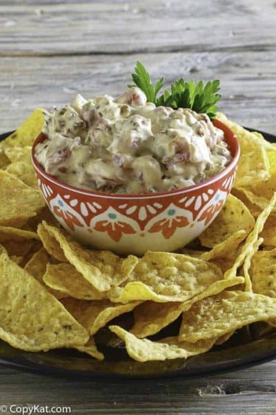Rotel Cream Cheese Dip with Sausage served in a bowl next to tortilla chips.