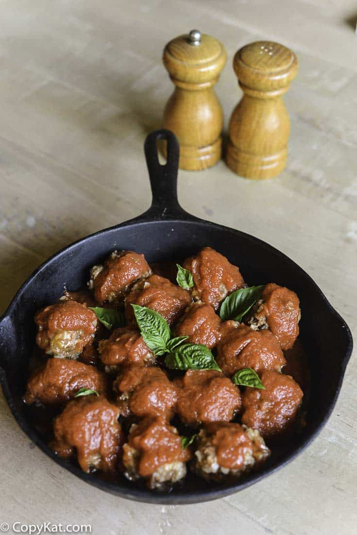 Classic Porcupine Meatballs - beef & rice meatballs - are baked in a savory tomato sauce until they are tender and bursting with flavor! Comfort food at it's best. #onthestove #meatballs #cheap |copykat.com