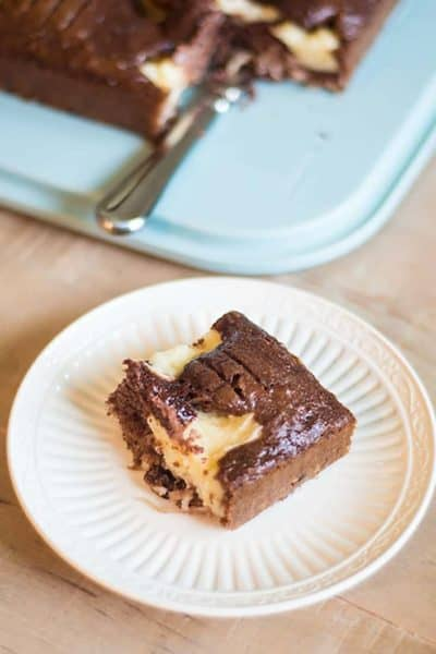 Enjoy this Earthquake cake, it's the perfect combination of German Chocolate Cake and Cheese cake filling. #chocolate #cheesecake #cake #cakemix